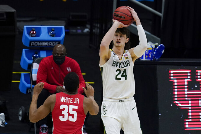 Baylor guard Matthew Mayer (24) shoots over Houston forward Fabian White Jr. (35) during the first half of a men's Final Four NCAA college basketball tournament semifinal game, Saturday, April 3, 2021, at Lucas Oil Stadium in Indianapolis. (AP Photo/Michael Conroy)