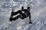 A snowboarder practices for the Big Air Atlanta snowboard and ski competition at SunTrust Park, Thursday, Dec. 19, 2019, in Atlanta. (AP Photo/John Bazemore)