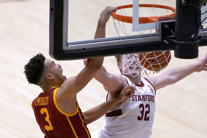 Southern California forward Isaiah Mobley (3) dunks against Stanford forward Lukas Kisunas (32) during the second half of an NCAA college basketball game in Stanford, Calif., Tuesday, Feb. 2, 2021. Southern California won 72-66.(AP Photo/Tony Avelar)