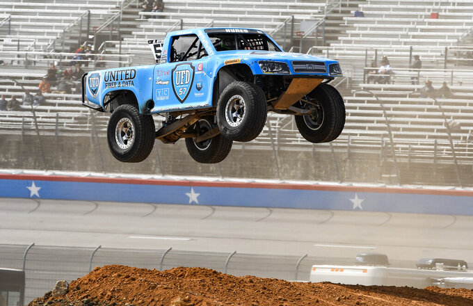Bill Hynes attempts a jump during the Outdoor Powersports Offroad Rumble SST Race prior to a NASCAR Cup auto race at Texas Motor Speedway, Sunday, March 31, 2019, in Fort Worth, Texas. (AP Photo/Larry Papke)