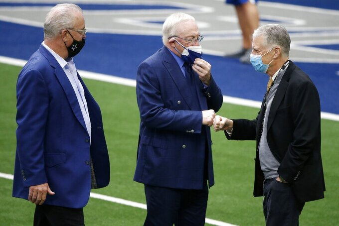Dallas Cowboys chief operating officer/director of player personnel Stephen Jones, left, and owner Jerry Jones, center, greet Pittsburgh Steelers team owner Art Rooney II, right, during team warmups before an NFL football game in Arlington, Texas, Sunday, Nov. 8, 2020. (AP Photo/Michael Ainsworth)