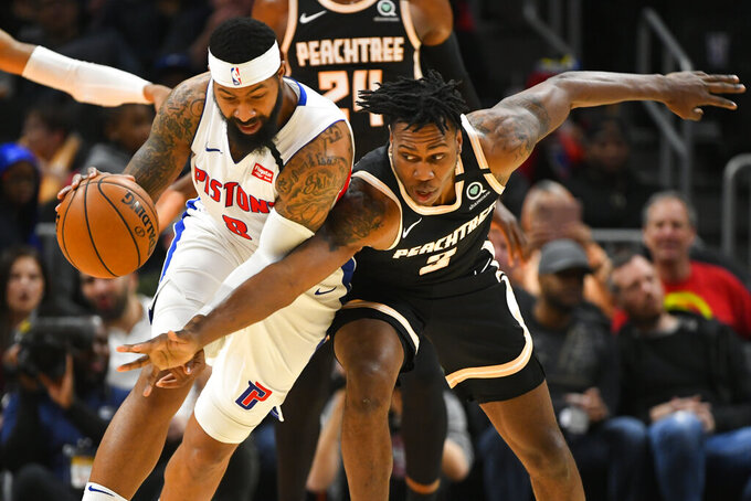 Atlanta Hawks guard Treveon Graham, right, reaches in against Detroit Pistons forward Markieff Morris, left, during the second half of an NBA basketball game Saturday, Jan. 18, 2020, in Atlanta. (AP Photo/John Amis)