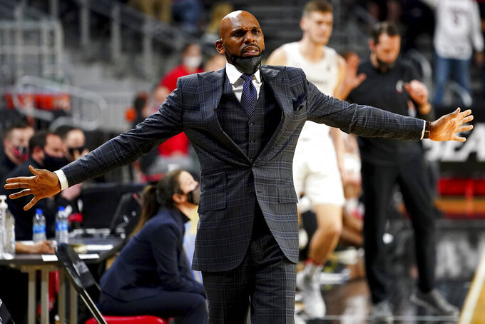 Vanderbilt coach Jerry Stackhouse reacts after a stoppage in play during the first half of the team's NCAA college basketball game against Cincinnati on Thursday, March 4, 2021, in Cincinnati. (Kareem Elgazzar/The Cincinnati Enquirer via AP)