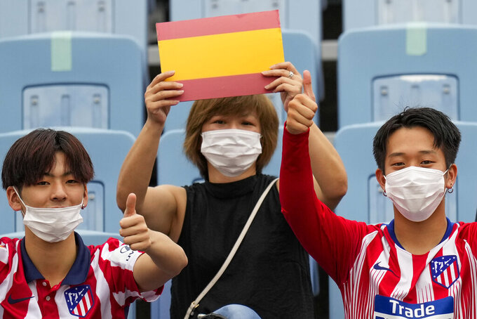 A fan holds Spains colors prior to a men's quarterfinal soccer match between Spain and Ivory Coast at the 2020 Summer Olympics, Saturday, July 31, 2021, in Rifu, Japan, Tokyo. (AP Photo/Andre Penner)
