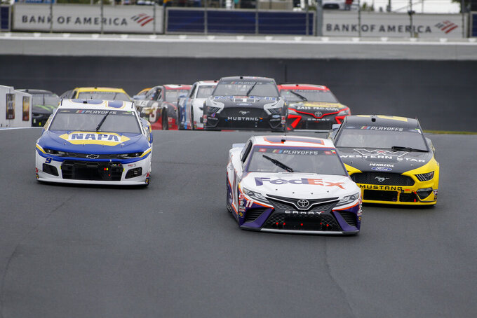 (L-R) Chase Elliott, Denny Hamlin and Brad Keselowski lead the way through Turn 7 in a NASCAR Cup Series auto race at Charlotte Motor Speedway in Concord, N.C., Sunday, Oct. 11, 2020. (AP Photo/Nell Redmond)