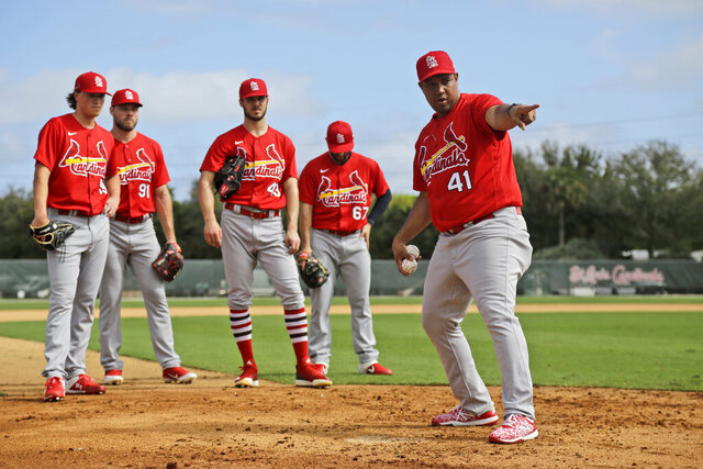 St. Louis Cardinals pitchers listen as coach Dernier Orozco (41) instructs them on covering home plate during spring training baseball practice Sunday, Feb. 16, 2020, in Jupiter, Fla. (AP Photo/Jeff Roberson)