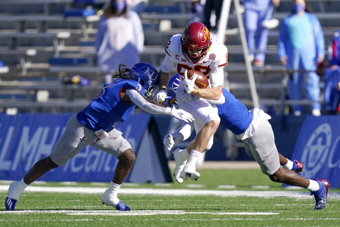 Iowa State wide receiver Landen Akers, center, splits Kansas defenders Ricky Thomas, left, and Karon Prunty, right, during the first half of an NCAA college football game in Lawrence, Kan., Saturday, Oct. 31, 2020. (AP Photo/Orlin Wagner)