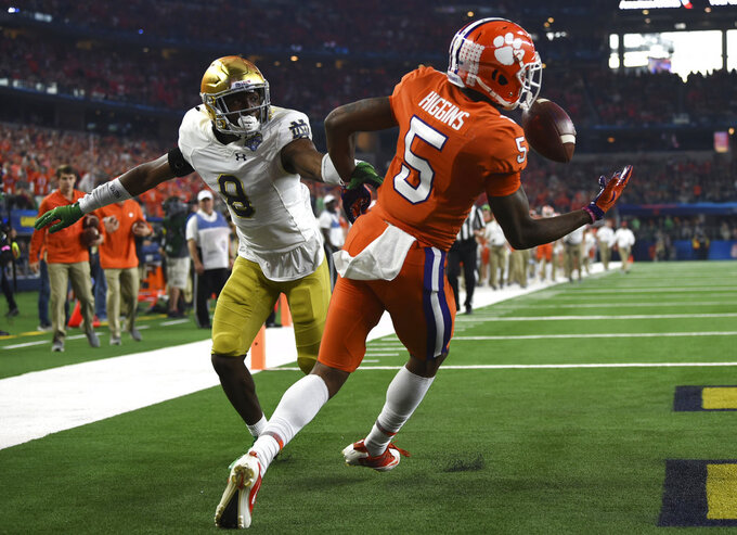 Notre Dame cornerback Donte Vaughn (8) watches as Clemson wide receiver Tee Higgins (5) reaches out to grab a ball tipped by Vaughn for a touchdown in the first half of the NCAA Cotton Bowl semi-final playoff football game, Saturday, Dec. 29, 2018, in Arlington, Texas. (AP Photo/Jeffrey McWhorter)