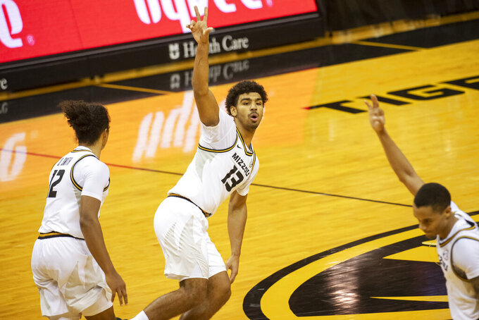 Missouri's Mark Smith, center, celebrates a 3-point basket with teammates during the second half of an NCAA college basketball game against Oral Roberts on Wednesday, Nov. 25, 2020, in Columbia, Mo. (AP Photo/L.G. Patterson)