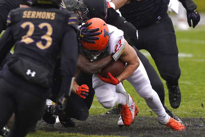 Illinois running back Conner Lillig (23) is tackled by Northwestern defenders during the second half of an NCAA college football game in Evanston, Ill., Saturday, Dec. 12, 2020. Northwestern won 28-10. (AP Photo/Nam Y. Huh)