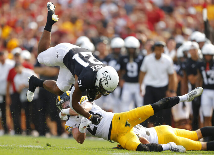Iowa State running back Jirehl Brock (21) runs for a first down as he gets tripped up by Iowa defensive back Jack Koerner (28) during the first half of an NCAA college football game, Saturday, Sept. 11, 2021, in Ames, Iowa. (AP Photo/Matthew Putney)
