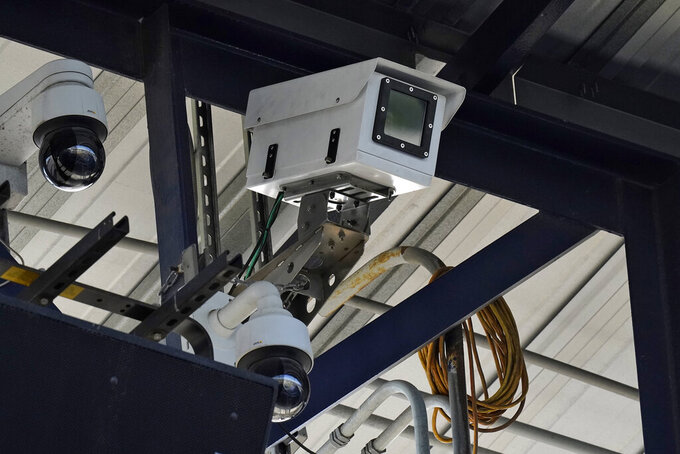 One of the cameras used for automatic balls and strike calls is shown during the first inning of a Low A Southeast league baseball game between the Dunedin Blue Jays and the Tampa Tarpons at George M. Steinbrenner Field Tuesday, May 4, 2021, in Tampa, Fla. The game is one of the first in the league to use automatic calls. (AP Photo/Chris O'Meara)