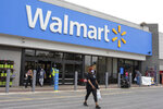 In this image for the Howard Center for Investigative Journalism at the University of Maryland's Philip Merrill College of Journalism, shoppers walk out of a Walmart store in Waldorf, Md., May 7, 2021. The Occupational Safety and Health Administration has not cited the nation's largest retailer despite employee complaints, illnesses and deaths at Walmart facilities across the country. The company says there is no proof that employees contracted COVID-19 at work. (Brittany N. Gaddy/University of Maryland via AP)