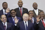 Russian President Vladimir Putin, center, poses for a photo with leaders of African countries at the Russia-Africa summit in the Black Sea resort of Sochi, Russia, Thursday, Oct. 24, 2019. (Valery Sharifulin, TASS News Agency Pool Photo via AP)