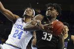 UCLA forward Jalen Hill, left, fouls Washington forward Isaiah Stewart during the second half of an NCAA college basketball game in Los Angeles, Saturday, Feb. 15, 2020. (AP Photo/Chris Carlson)