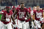 Arkansas wide receiver Treylon Burks (16) and teammates celebrate after their win in an NCAA college football game against Texas A&M in Arlington, Texas, Saturday, Sept. 25, 2021. (AP Photo/Tony Gutierrez)