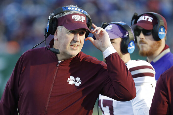 Mississippi State head coach Joe Moorhead watches from the sideline in the first half of the Music City Bowl NCAA college football game against Louisville Monday, Dec. 30, 2019, in Nashville, Tenn. (AP Photo/Mark Humphrey)