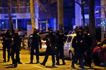 French police officers stand in the Neudorf neighborhood, in Strasbourg, eastern France, Thursday, Dec. 13, 2018. French police conducted an intense but ultimately fruitless search operation Thursday in the Strasbourg neighborhood where a suspected gunman who killed three people and wounded 13 near a popular Christmas market was last seen. (AP Photo/Christophe Ena)