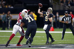 New Orleans Saints quarterback Drew Brees (9) passes as offensive tackle Ryan Ramczyk (71) blocks Arizona Cardinals linebacker Chandler Jones (55) in the first half of an NFL football game in New Orleans, Sunday, Oct. 27, 2019. (AP Photo/Butch Dill)