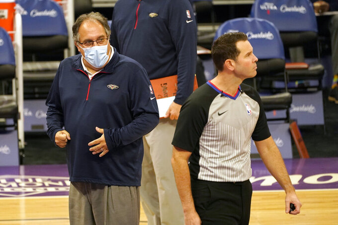 Referee Brian Forte, right, walks away from New Orleans Pelicans coach Stan Van Gundy after discussing a call during the first quarter of an NBA basketball game against the Sacramento Kings in Sacramento, Calif., Sunday, Jan. 17, 2021. (AP Photo/Rich Pedroncelli)