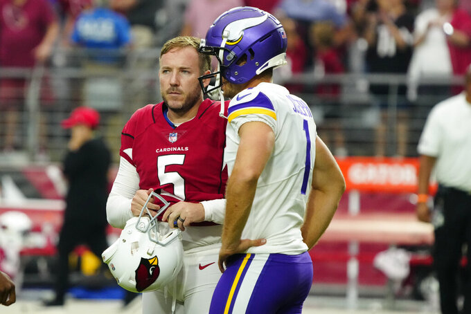Arizona Cardinals kicker Matt Prater (5) talks with Minnesota Vikings kicker Greg Joseph (1) after an NFL football game, Sunday, Sept. 19, 2021, in Glendale, Ariz. The Cardinals won 34-33. (AP Photo/Rick Scuteri)