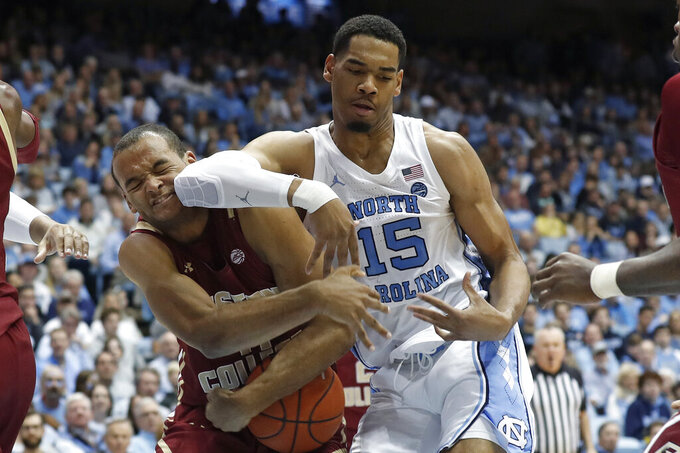 Boston College forward Steffon Mitchell and North Carolina forward Garrison Brooks (15) struggle for the ball during the first half of an NCAA college basketball game in Chapel Hill, N.C., Saturday, Feb. 1, 2020. (AP Photo/Gerry Broome)