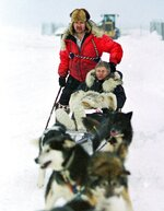 In this Jan. 19, 2000, file photo, U.S. Census Bureau director Kenneth Prewitt, seated, gets a dog sled ride into town by Harold Johnson after arriving for the first count in the Eskimo village of Unalakleet, Alaska. The 2020 Census kicks off Tuesday, Jan. 21, 2020, in remote Alaska. The first count in the Bering Sea community of Toksook Bay. The Census always starts in remote parts of the nation's largest state out of tradition and necessity. (AP Photo/Al Grillo, File)