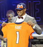 Iowa tight end Noah Fant poses with his new jersey after the Denver Broncos selected Fant in the first round at the NFL football draft, Thursday, April 25, 2019, in Nashville, Tenn. (AP Photo/Steve Helber)