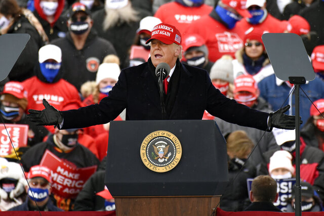 President Donald Trump speaks during a campaign rally at Michigan Sports Stars Park, Sunday, Nov. 1, 2020, in Washington, Mich.  (AP Photo/Jose Juarez)