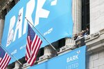 This photo provided by the New York Stock exchange shows a banner for BARK outside the New York Stock Exchange in New York on Wednesday, June 2, 2021.  (Courtney Crow/NYSE via AP)