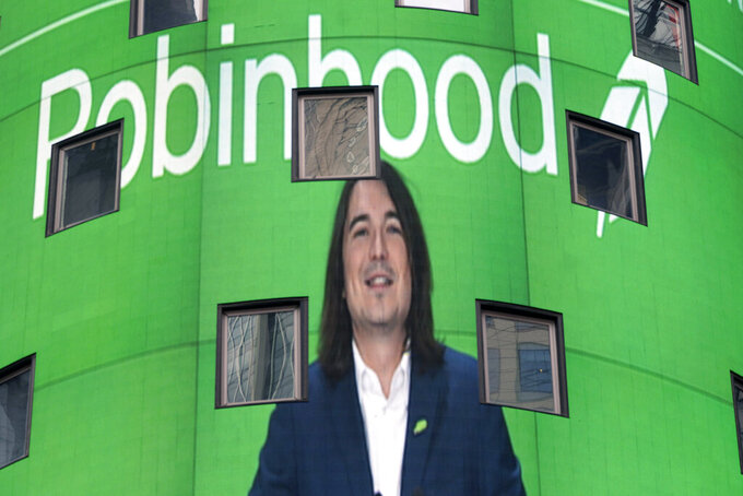 Vladimir Tenev, CEO and co-founder of Robinhood, is shown on an electronic screen at Nasdaq in New York's Times Square following his company's IPO, Thursday, July 29, 2021. (AP Photo/Mark Lennihan)