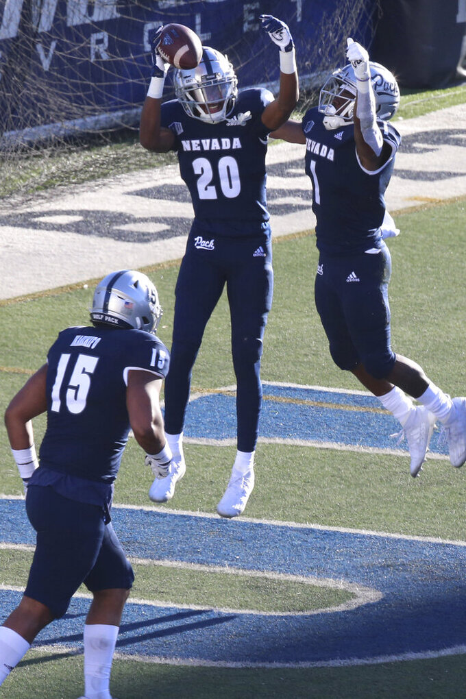Nevada wide receiver Joshua Fixel (20) celebrates his first-quarter touchdown while playing against Wyoming State during an NCAA college football game Saturday, Oct. 24, 2020, in Reno, Nev. (AP Photo/Lance Iversen)