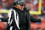 Oakland Raiders head coach Jon Gruden, right, has a word with field judge Dyrol Prioleau, left, after a call during the second half of an NFL football game against the Denver Broncos, Sunday, Dec. 29, 2019, in Denver. (AP Photo/David Zalubowski)