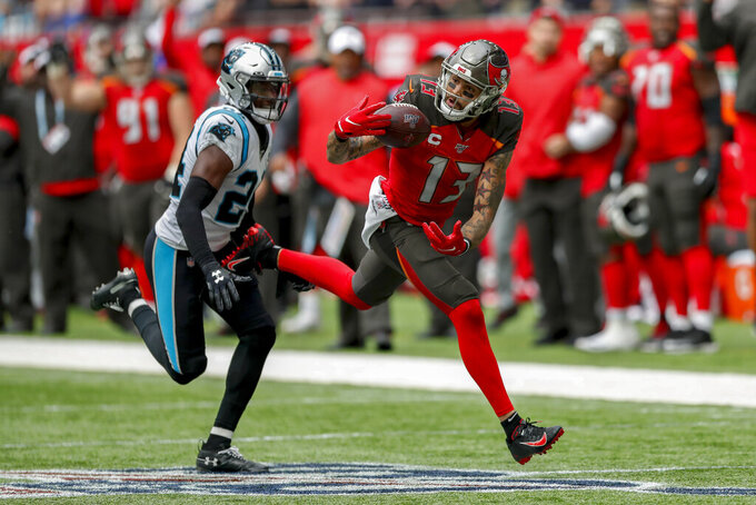 Tampa Bay Buccaneers wide receiver Mike Evans (13) can't make the catch on a pass down field as Carolina Panthers cornerback James Bradberry (24) defends during the second quarter of an NFL football game, Sunday, Oct. 13, 2019, at Tottenham Hotspur Stadium in London. (AP Photo/Alastair Grant)