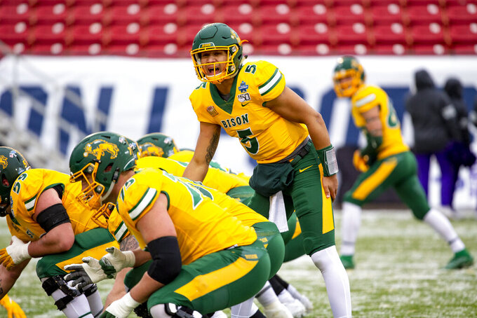 North Dakota State quarterback Trey Lance (5) yells instructions to his team during warmups before the FCS championship NCAA college football game against James Madison, Saturday, Jan. 11, 2020, in Frisco, Texas. (AP Photo/Sam Hodde)
