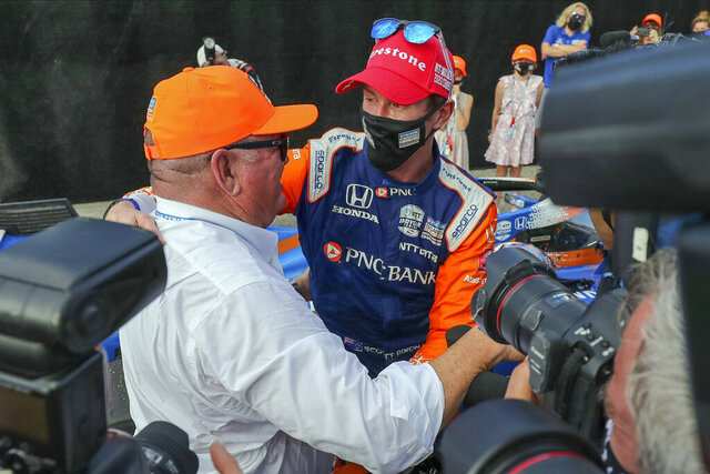 Team owner Chip Ganassi, left, congratulates Scott Dixon on winning the NTT IndyCar Series Championship following an IndyCar auto race Sunday, Oct. 25, 2020, in St. Petersburg, Fla. (AP Photo/Mike Carlson)