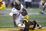 Missouri running back Tyler Badie (1) is tackled by Wyoming's Alijah Halliburton (3) in the first quarter of an NCAA college football game, Saturday, Aug. 31, 2019. in Laramie, Wyo. (AP Photo/Michael Smith)