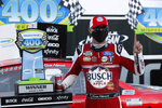 Kevin Harvick celebrates after winning a NASCAR Cup Series auto race at Michigan International Speedway in Brooklyn, Mich., Sunday, Aug. 9, 2020. (AP Photo/Paul Sancya)