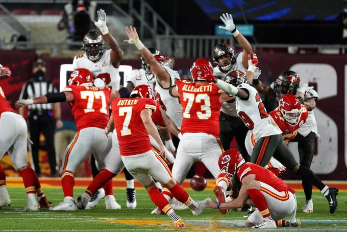 Kansas City Chiefs kicker Harrison Butker kicks a 34-yard field goal during the first half of the NFL Super Bowl 55 football game against the Tampa Bay Buccaneers, Sunday, Feb. 7, 2021, in Tampa, Fla. (AP Photo/Chris O'Meara)