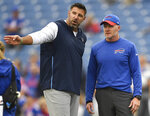 FILE - In this Sunday, Oct. 7, 2018, file photo, Tennessee Titans head coach Mike Vrabel, left, talks to Buffalo Bills head coach Sean McDermott prior to an NFL football game, in Orchard Park, N.Y. The NFL's ranks of undefeated teams should thin by one Tuesday night, Oct. 13, 2020, when the Buffalo Bills and Tennessee Titans finally meet in a rescheduled game. (AP Photo/Adrian Kraus, File)
