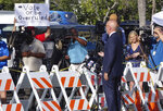 A protester holds a sign as U.S. Rep. Ted Deutch (D-Fla.)speaks Monday, Nov. 12, 2018, at the Broward Supervisor of Elections office in Lauderhill, Fla. The Florida recount continued Monday in Broward County. (Joe Cavaretta /South Florida Sun-Sentinel via AP)