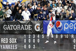 Boston Red Sox right fielder Mookie Betts leaps for but can't get to a solo home run by New York Yankees' Clint Frazier during the fourth inning of a baseball game Tuesday, April 16, 2019, in New York. (AP Photo/Kathy Willens)
