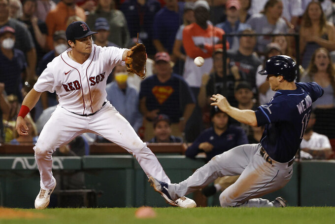 Boston Red Sox's Bobby Dalbec gets the throw at third base to tag out Tampa Bay Rays' Joey Wendle for the final out in the Red Sox's 2-1 win over Tampa Bay Rays in a baseball game Wednesday, Sept. 8, 2021, at Fenway Park in Boston. (AP Photo/Winslow Townson)