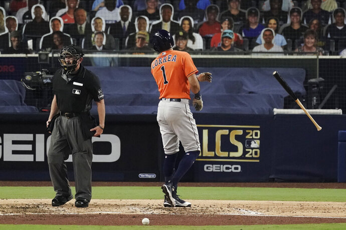 Houston Astros Carlos Correa tosses his bat and has words with home plate umpire Lance Barksdale after striking out during the fourth inning in Game 7 of a baseball American League Championship Series, Saturday, Oct. 17, 2020, in San Diego. (AP Photo/Jae C. Hong)