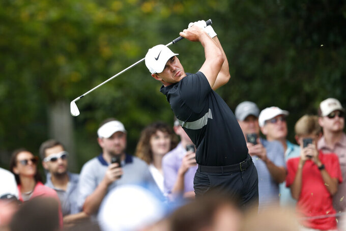 Brooks Koepka hits from the second tee during the final round of the Tour Championship golf tournament Sunday, Aug. 25, 2019, at East Lake Golf Club in Atlanta. (AP Photo/John Bazemore)