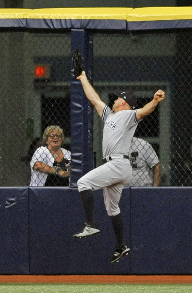 New York Yankees center fielder Brett Gardner makes a leaping catch at the warning track on a fly ball hit by Tampa Bay Rays' Brandon Lowe during the sixth inning of a baseball game Monday, Sept. 24, 2018, in St. Petersburg, Fla. (AP Photo/Steve Nesius)