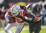 Mississippi wide receiver Braylon Sanders (13) is tackled by South Carolina defensive back R.J. Roderick (10) during an NCAA college football game at Vaught-Hemingway Stadium in Oxford, Miss. on Saturday, Nov. 3, 2018. (Bruce Newman/The Oxford Eagle via AP)