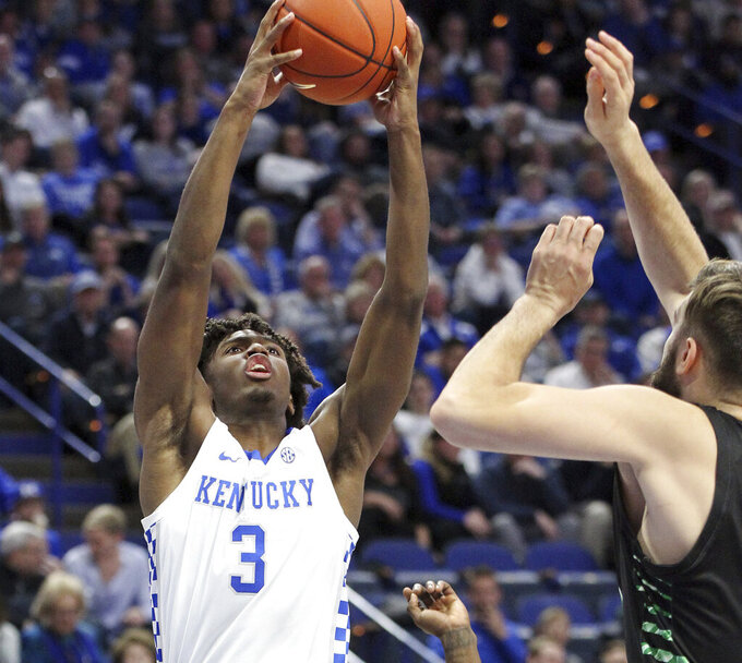 Kentucky's Tyrese Maxey (3) shoots near Utah Valley's Brandon Morley, right, during the second half of an NCAA college basketball game in Lexington, Ky., Monday, Nov. 18, 2019. Kentucky won 82-74. (AP Photo/James Crisp)