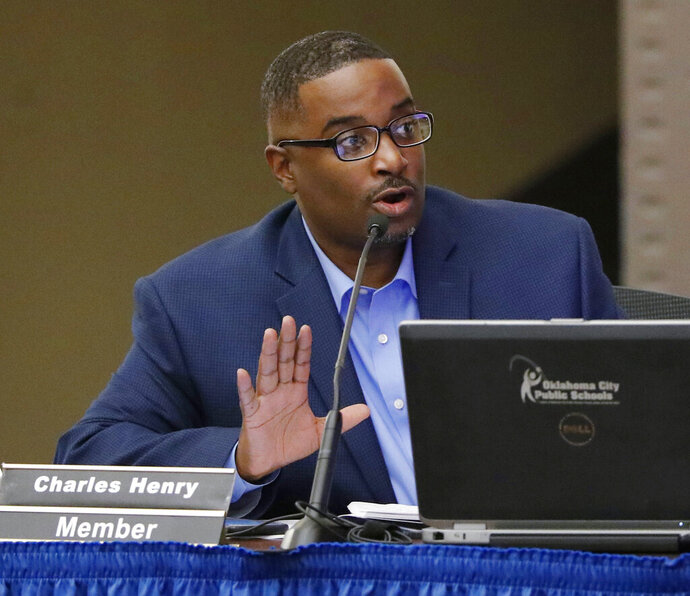 FILE - In this May 14, 2018, file photo, Oklahoma City school board member Charles Henry speaks at a board meeting in Oklahoma City.  In a court motion dated July 3, 2019, member Charles Henry asked a judge for a permanent injunction to stop the board from actions that he says violate his constitutional rights to free speech and due process. Henry obtained a temporary restraining order June 24 after a meeting agenda included a private discussion about possible discipline against Henry but cited no specific violations. (Doug Hoke/The Oklahoman via AP)