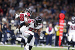 Atlanta Falcons defensive tackle Grady Jarrett (97) celebrates his sack with defensive end Takkarist McKinley (98) in the second half of an NFL football game against the New Orleans Saints in New Orleans, Sunday, Nov. 10, 2019. (AP Photo/Rusty Costanza)